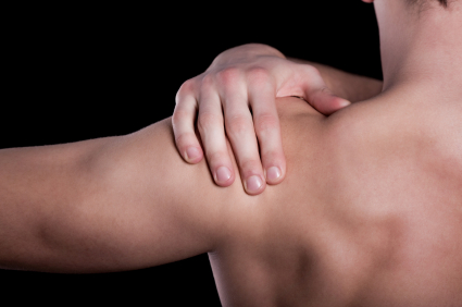 Man touching his shoulder