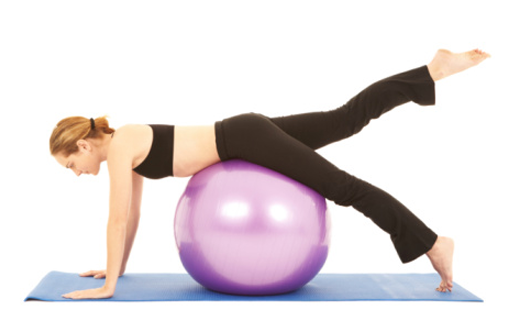 Woman stretching on a fit ball